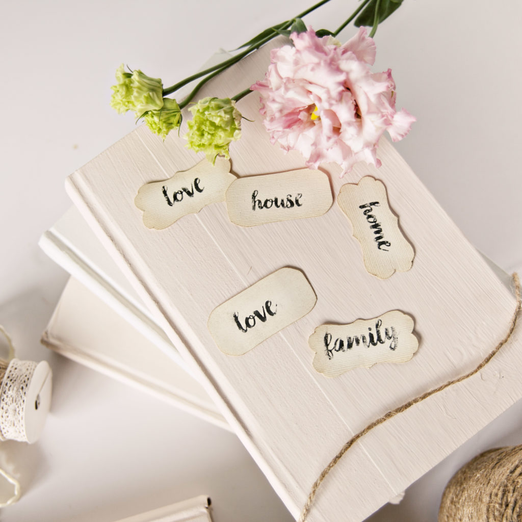 Want to give old books new life? Follow these simple steps for using A Makers' Studio Rescue Restore Paint, ChalkArt™, and alphabet stencils to create painted books with adorable DIY labels.