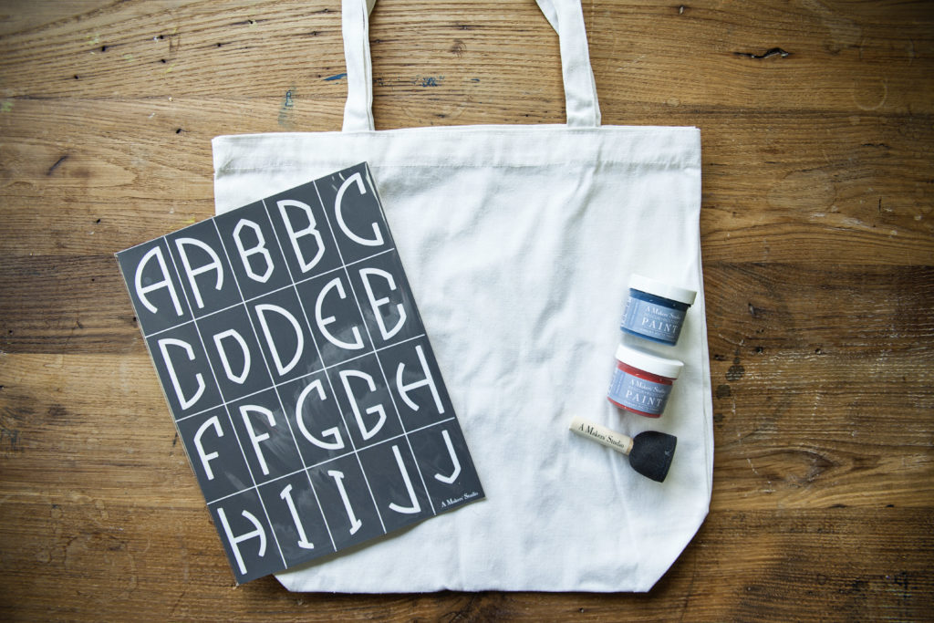 Want to craft your own DIY monogrammed tote bag? Follow these simple steps for using A Makers' Studio easy monogram stencils to create a DIY tote that is custom to you.
