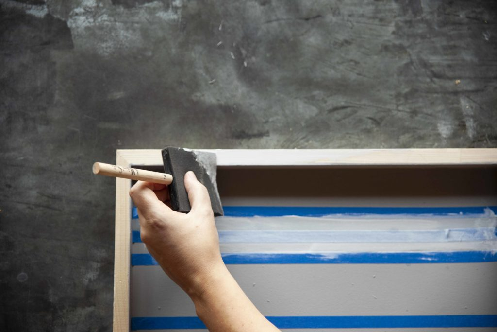 """See how to make a striped wooden sign with this simple tutorial. Using A Makers' Studio Rescue Restore Paint, ChalkArt™, and a lovely stencil, you can create a wooden sign that reads """"Gather"""" in no time. See the full striped wooden sign tutorial here."""
